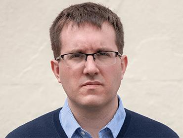 Portrait photo of Rupert Roker